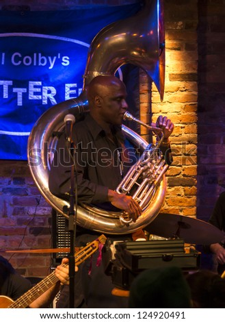 NEW YORK - JANUARY 12: Joe Daley sousaphone performs with Hazmat Modine band on stage as part of NYC Winter Jazz Festival at The Bitter End on January 12, 2013 in New York City - stock photo