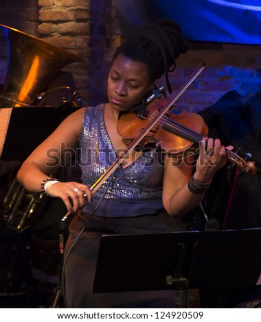 NEW YORK - JANUARY 12: Mazz Swift violin performs with Ghost Train Orchestra on stage as part of NYC Winter Jazz Festival at The Bitter End on January 12, 2013 in New York City - stock photo