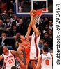 NEW YORK - JANUARY 17:  New York Knicks guard Landry Fields and Phoenix Suns center Robin Lopez battle for the ball on January 17 at Madison Square Garden in New York City. - stock photo