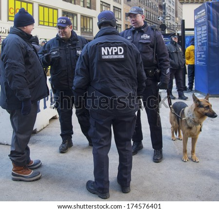 NEW YORK - JANUARY 30  NYPD counter terrorism officers and NYPD transit bureau K-9 police officer with K-9 dog providing security on Broadway during Super Bowl XLVIII week on January 30, 2014  - stock photo