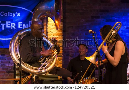 NEW YORK - JANUARY 12: Reut Regev trombone & Joe Daley sousaphone perform with Hazmat Modine band on stage as part of NYC Winter Jazz Festival at The Bitter End on January 12, 2013 in New York City - stock photo