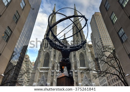 New York - January 24, 2016: Snow covered Atlas Statue at Rockefeller Center in New York. The Atlas Statue is a bronze statue across from St. Patrick's Cathedral in midtown Manhattan, New York City. - stock photo