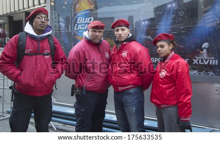 NEW YORK - JANUARY 30: The Guardian Angels Patrol on Broadway on January 30, 2014.The Guardian Angels is a non profit international volunteer organization of unarmed citizen crime patrollers - stock photo