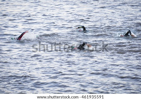 NEW YORK - JUL 24 2016: Athletes compete in the NYC Triathlon Race in New York on July 24 2016.  The swim portion measures 1.5 kilometers in the Hudson River along Riverside Park.