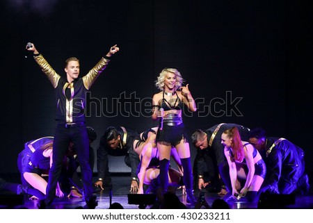 NEW YORK-JUL 9: Julianne Hough (R) and Derek Hough perform on stage during the Move Live On Tour at Radio City Music Hall on July 9, 2015 in New York City.