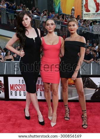 NEW YORK-JUL 27: (L-R) Models Ireland Baldwin, Alaia Baldwin and Hailey Baldwin attend the US Premiere of 'Mission: Impossible - Rogue Nation' in Times Square on July 27, 2015 in New York City. - stock photo