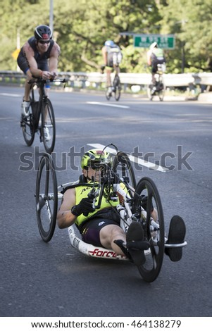 NEW YORK JUL 24 2016: ParaTriathletes compete in the NYC Triathlon Race, biking 40 kilometers mainly on the Henry Hudson Parkway in New York on the only International Distance triathlon in Manhattan.