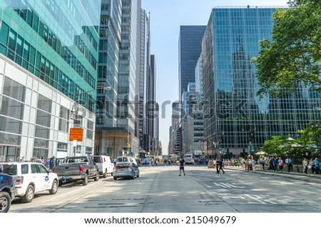 """NEW YORK - JUL 22: Sixth avenue with traffic and commercials on July 22, 2014 in New York. 6th Avenue is a major thoroughfare in Manhattan, on which traffic runs northbound, or """"uptown"""". - stock photo"""