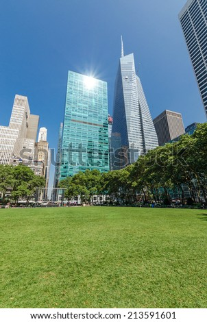 NEW YORK - JUL 22: The Great Lawn in Bryant Park on July 22, 2014 in New York. Bryant Park is a 9.603-acre public park located in the New York City borough of Manhattan. - stock photo