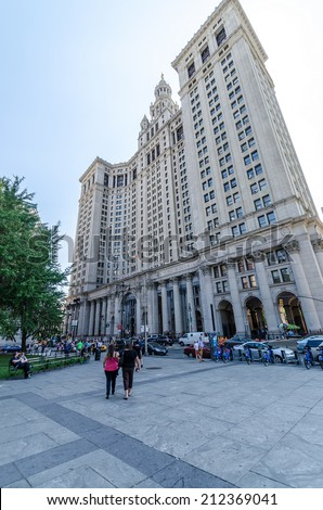 NEW YORK - JUL 17: The Manhattan Municipal Building in July 17, 2014 on NYC. It is a 40-story building built to accommodate increased governmental space demands after the consolidation of 5 boroughs. - stock photo