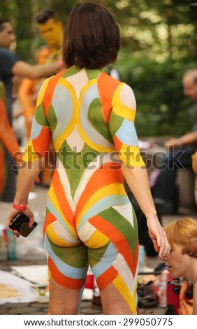 NEW YORK - JULY 18, 2015: Artists paint 100 fully nude models of all shapes and sizes during second NYC Body Painting Day in midtown Manhattan featuring artist Andy Golub in New York  - stock photo