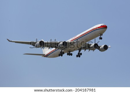 NEW YORK -JULY 10:China Eastern Airlines Airbus A340 in New York sky before landing at JFK Airport on July 10, 2014. It is a major Chinese airline operating international, domestic and regional routes - stock photo