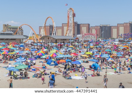 NEW YORK, JULY 4, 2016: Crowded beach in Coney Island - people enjoy beach time waiting for 4th July fireworks display - stock photo