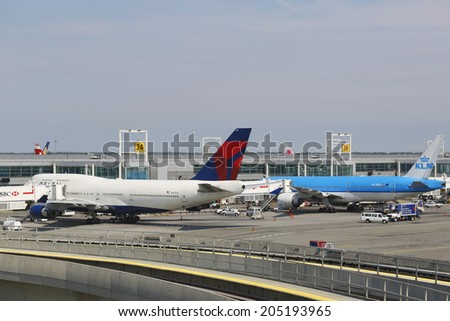 NEW YORK- JULY 10: Delta Airline Boeing 747 and KLM Boeing 777 at the gates at the Terminal 4 at John F Kennedy International Airport in New York on July 10, 2014 - stock photo