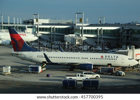 NEW YORK- JULY 2, 2016: Delta Airlines plane on tarmac at Terminal 4 at JFK International Airport. JFK is one of the biggest airports in the world with 4 runways and 8 terminals