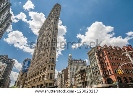 NEW YORK - JULY 10: Flatiron Building on July 10, 2012 in New York. The Flatiron Building is located at 175 Fifth Avenue in the borough of Manhattan, New York City. - stock photo