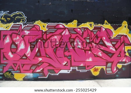 NEW YORK - JULY 24, 2014: Graffiti art at East Williamsburg in Brooklyn. Outdoor art gallery known as the Bushwick Collective has most diverse collection of street art in Brooklyn - stock photo