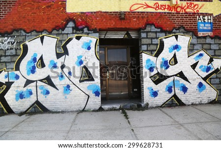 NEW YORK - JULY 23, 2015: Graffiti art at East Williamsburg in Brooklyn.Outdoor art gallery known as the Bushwick Collective has most diverse collection of street art in Brooklyn