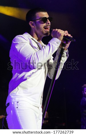 NEW YORK - JULY 20: Joe Jonas of the Jonas Brothers performs in concert at Jones Beach on July 20, 2013 in New York.