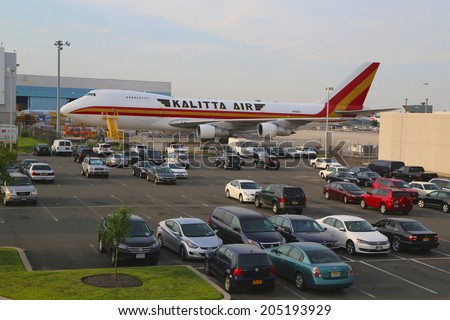 NEW YORK -JULY 10: Kalitta Air Boeing 747 at JFK Airport in New York on July 10, 2014. Kalitta Air is an American cargo airline. It operates international scheduled and ad-hoc cargo charter services - stock photo