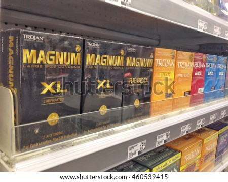 New York, July 28, 2016: Magnum condoms are for sale on a shelf in a pharmacy.