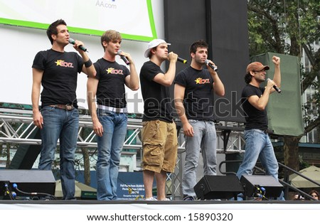 NEW YORK - JULY 31:  Michael Kadin with the cast performed in the Altar Boyz at The Broadway in Bryant Park in NYC - a free public event on July 31, 2008 - stock photo