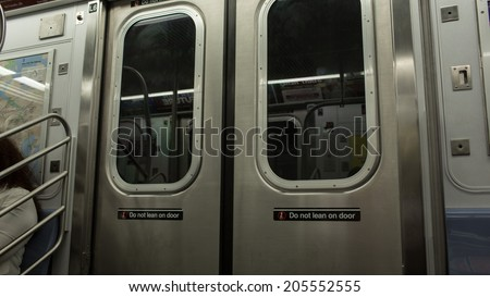 NEW YORK - JULY 14, 2014: MTA subway train doors and windows in New York. The NYC Subway is a rapid transit/transportation system in the City of NY. - stock photo