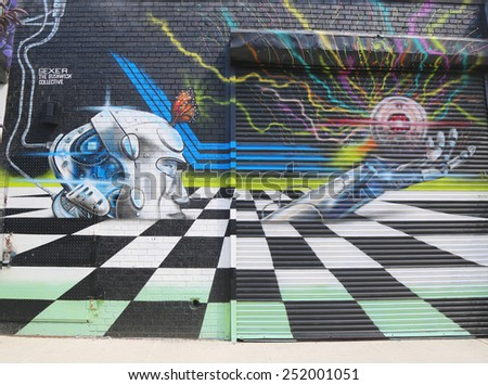NEW YORK - JULY 24, 2014: Mural art at East Williamsburg in Brooklyn. Outdoor art gallery known as the Bushwick Collective has most diverse collection of street art in Brooklyn