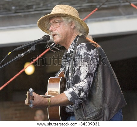 NEW YORK - JULY 30: Musician Arlo Guthrie performs at Battery Park's Castle Clinton on July 30, 2009 in New York City. - stock photo