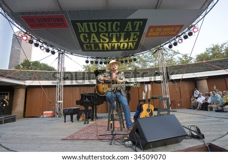 NEW YORK - JULY 30: Musician Arlo Guthrie speaks to the audience as he performs at Battery Park's Castle Clinton on July 30, 2009 in New York City. - stock photo