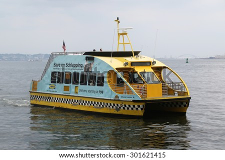 NEW YORK - JULY 30, 2015: New York City Water Taxi in the New York harbor.  NYC Water Taxi has been servicing NYC commuters since 2002  - stock photo