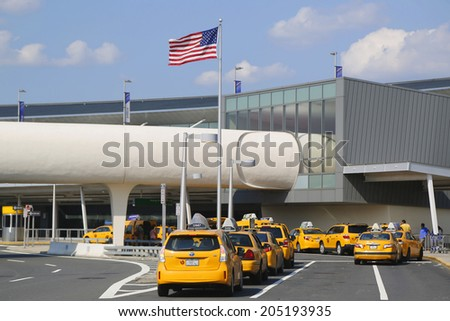NEW YORK- JULY 10: New York Taxi line next to JetBlue Terminal 5 at John F Kennedy International Airport in New York on July 10, 2014.  - stock photo