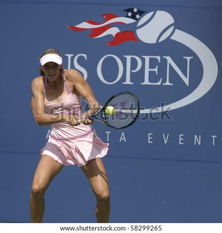 NEW YORK- JULY 31: Nicole Vaidisova in action against Justine Henin-Hardenne July 31, 2004 in Flushing, NY. Henin-Hardenne won the match to advance on in the 2004 US Open. - stock photo