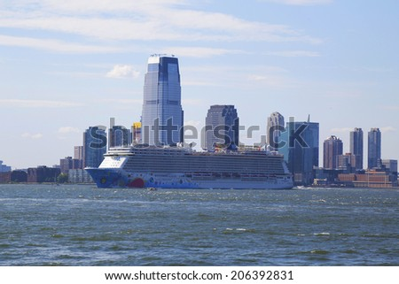 NEW YORK - JULY 6: Norwegian Breakaway Cruise Ship leaving New York on July 6, 2014. Newest Norwegian Cruise Line Ship is the world's eighth largest cruise ship start voyages on May 12, 2013  - stock photo