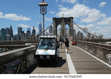 NEW YORK - JULY 19, 2016: NYPD provides security at the Brooklyn Bridge. The New York Police Department, established in 1845, is the largest police force in USA