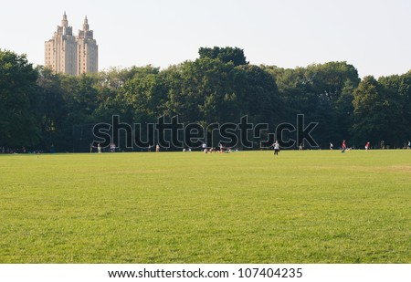 NEW YORK - JULY 1: People enjoying outdoors activities Central Park on July 1, 2012 in New York. The park is the most visited urban park in the United States with 35 million visitors annually. - stock photo