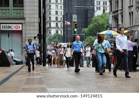 NEW YORK - JULY 2: People hurry in Lower Manhattan on July 2, 2013 in New York. Almost 19 million people live in New York City metropolitan area. - stock photo