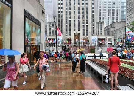 NEW YORK - JULY 1: People visit Rockefeller Center on July 1, 2013 in New York. Rockefeller Center is one of most recognized landmarks in the United States and is a National Historic Landmark. - stock photo