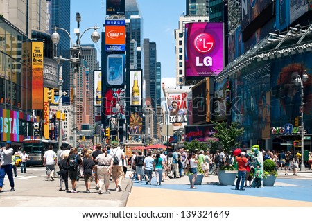 NEW YORK - JULY 1: People walking in Times Square. T. S. is a busy tourist intersection of commerce Advertisements and a famous street of New York City and US, seen on July 1, 2012 in New York, NY. - stock photo