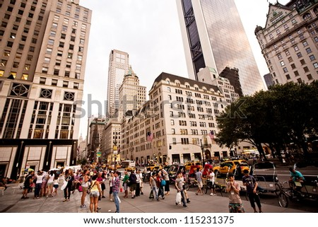 NEW YORK - JULY 21: Plaza hotel on 5th Avenue on July 21 2012 in New York, USA. 5th Avenue is a central road of Manhattan, the most expensive shops and apartmens situated here - stock photo