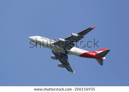 NEW YORK - JULY 20: Qantas Airline Boeing 747-400 in New York sky before landing at JFK Airport on July 20, 2014 - stock photo