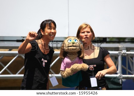NEW YORK - JULY 17: Sala Iwamatsu and Carey Anderson Performed in the Avenue Q - The Broadway at Bryant Park in NYC - a free public event on July 17, 2008 - stock photo