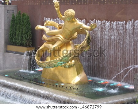 NEW YORK - JULY 17: Statue of Prometheus above the ice rink at the Rockefeller Center on July 17, 2013 in Manhattan New York. It was created by American sculptor Paul Manship. - stock photo