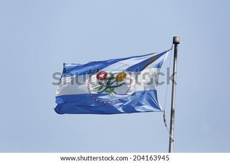 NEW YORK - JULY 8 The Borough of Queens official flag in New York on July 8, 2014. Queens is the easternmost and largest in area of the five boroughs of New York City