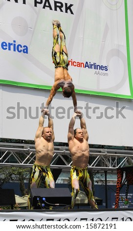 NEW YORK - JULY 31: The cast of  Cirque Dreams Jungle Fantasy performed at The Broadway in Bryant Park in NYC - a free public event on July 31, 2008 - stock photo