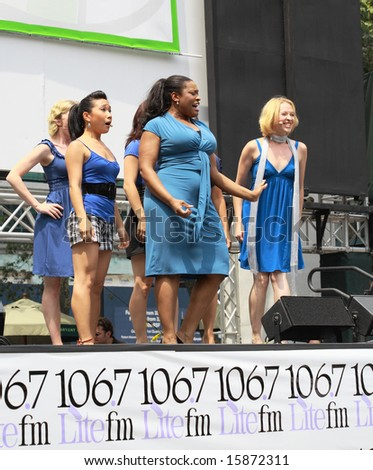 NEW YORK - JULY 31:  The cast of The Little Mermaid at The Broadway in Bryant Park in NYC - a free public event on July 31, 2008 - stock photo
