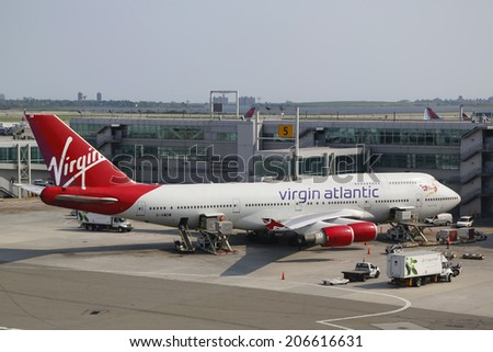 NEW YORK - JULY 22: Virgin Atlantic Boeing 747 at the gate at the Terminal 4 in JFK Airport in NY on July 22, 2014.  - stock photo