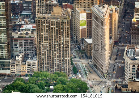 NEW YORK - JUN 9: Flat Iron building facade aerial view on June 9, 2013. Completed in 1902, it is considered to be one of the first skyscrapers ever built - stock photo