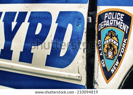 NEW YORK - JUN 14: New York City Police Department car in New York City on June 14, 2013. NYPD is one of the oldest police departments and the largest municipal police force in United States. - stock photo