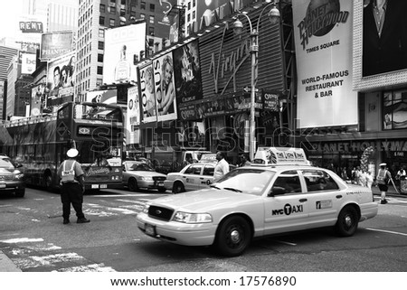 NEW YORK - JUNE 8: A NYC traffic officer directs traffic in this image taken in New York City's Times Square area on June 8, 2008 - stock photo